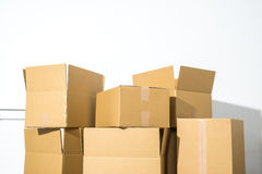 Pile of cardboard boxes on white background with box shadow Stock Photos
