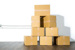 Pile of cardboard boxes on white background with box shadow Stock Images