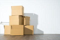 Pile of cardboard boxes on white background with box shadow Stock Photo
