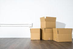 Pile of cardboard boxes on white background with box shadow royalty free stock photography