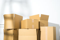 Pile of cardboard boxes on white background with  Ladder shadow Royalty Free Stock Image