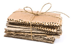 The pile of cardboard with rope and bow Royalty Free Stock Photography