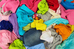 Pile of carelessly scattered clothes. Closeup pile of carelessly scattered clothes Stock Images