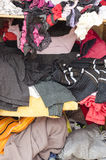 Pile of carelessly scattered clothes in wardrobe Stock Photo