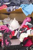Pile of carelessly scattered clothes in wardrobe Royalty Free Stock Photo