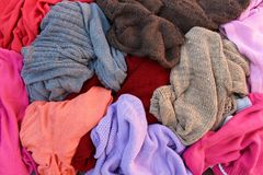 Pile of carelessly scattered clothes. Pile of carelessly warm scattered clothes Royalty Free Stock Photography