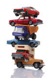 Pile of cars. Pile of toy cars isolated on white vertical shot Stock Image