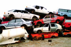 Pile of cars. Heap of cars, stacked on top of each other in a junk yard royalty free stock images