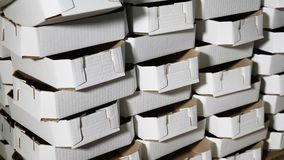 Pile of carton put one on another in storage. Industry concept. pile of cardboard boxes . 4k stock footage