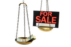 Pile of Cash and For Sale Sign on a Scale Isolated Stock Image