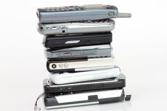 Pile of cell phones on white background Royalty Free Stock Photography