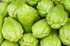 Pile chayote fresh vegetables on the market Royalty Free Stock Image