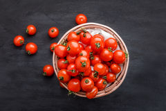 Pile of cherry tomatoes in a rattan basket Royalty Free Stock Photo