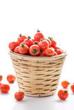 Pile of cherry tomatoes in a rattan basket Stock Image