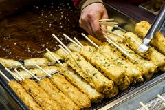 A pile of cherryThe handmade fish cake at the Traditional Market in south korea stock photo