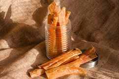 Pile Chewing sticks for dogs. Bundles of Air Dried beef tendons. Natural treats for large and small dogs royalty free stock photography