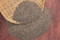 Pile of chia seeds and traditional sifter Royalty Free Stock Photo