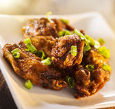 Pile of chicken wings on plate. Stock Photography