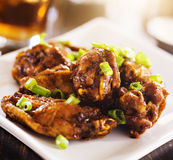 Pile of chicken wings on plate. Royalty Free Stock Images