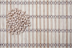Pile of chickpeas on striped background. Pile of chickpeas on striped pattern background Royalty Free Stock Photography