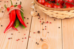 Pile of chilli pepper with tomatoes Stock Images