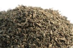Pile of chinese gunpowder tea. Closeup of a pile with green chinese gunpowder tea stock photos