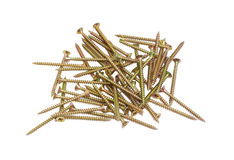 Pile of chipboard screws on a light background. Pile of zinc plated chipboard screws with countersunk heads on a light background Stock Images