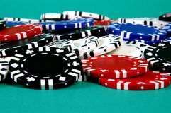 Pile of chips. A pile of poker chips against a green background Stock Photo
