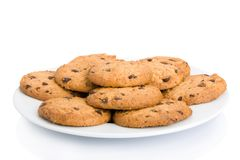 Pile of chocolate chip cookies on a dish Stock Images