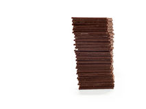 Pile of Chocolate chunks isolated on white background. Stock Photo