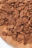 Pile of chocolate cornflakes on the wooden board Stock Images