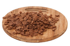 Pile of chocolate cornflakes on the wooden board Stock Image