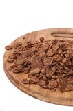 Pile of chocolate cornflakes on the wooden board Royalty Free Stock Image