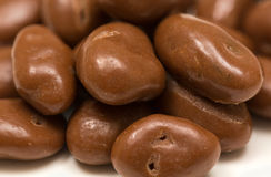 Pile of chocolate raisins on white stock photography