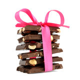 Pile of chocolate with ribbon Stock Photos