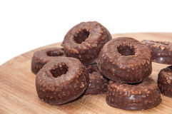 Pile of chocolate round cookies with hole in the center Stock Photo