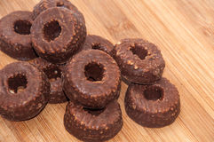 Pile of chocolate round cookies with hole in the center Royalty Free Stock Photos
