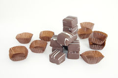 A pile of chocolates on white backroung. A pile of praline chocolates isolated on white backroung Stock Images