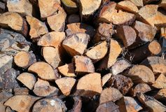 Pile of chopped fire wood prepared for winter. Royalty Free Stock Photo
