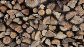 Pile of chopped fire wood prepared for winter, wood textures.  stock footage