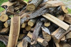 A pile of chopped firewood. Background Royalty Free Stock Image