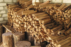 Pile of firewood in woodshed Royalty Free Stock Images