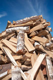 Pile of chopped tree trunk. Huge pile of chopped tree trunk with blue sky on background. Firewood Stock Photos