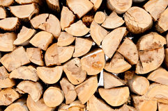 Pile of chopped unseasoned firewood logs. Natural wooden background Chopped firewood on stack Stock Photos