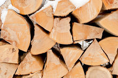Pile of chopped unseasoned firewood logs. Natural wooden background Chopped firewood on stack Royalty Free Stock Photography