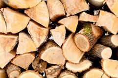 Pile of chopped unseasoned firewood logs. Natural wooden background Chopped firewood on stack Stock Photography