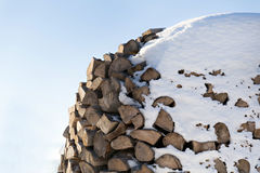 Pile of chopped wood. Closeup of chopped firewood covered with snow, copy space Royalty Free Stock Image