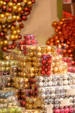 Pile of Christmas baubles in plastic boxes. In decoration store Royalty Free Stock Photos