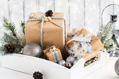 Pile of christmas gift box with decorations on a wooden tray Royalty Free Stock Photo