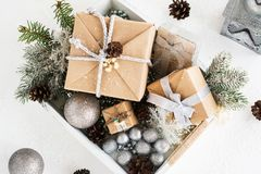 Pile of christmas gift box with decorations on a wooden tray Royalty Free Stock Images